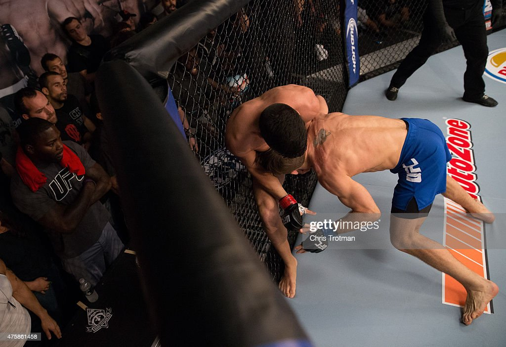 Nate Coy pushes Vicente Luque up against the cage during the filming of The Ultimate Fighter American Top Team vs Blackzilians on February 17 2015 in...