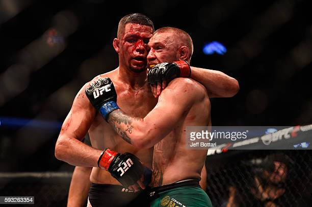 Nate Diaz and Conor McGregor of Ireland embrace after finishing five rounds in their welterweight bout during the UFC 202 event at TMobile Arena on...