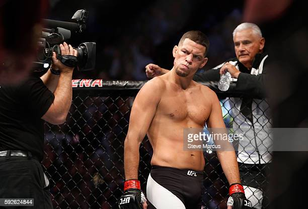 Nate Diaz eyes Conor McGregor from across the Octagon before their welterweight rematch at the UFC 202 event at TMobile Arena on August 20 2016 in...