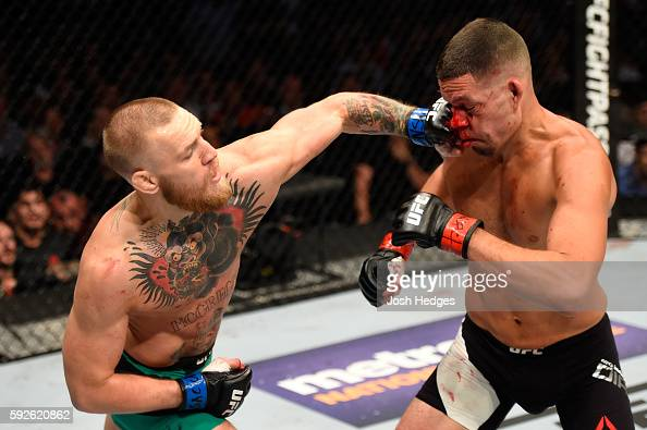 Nate Diaz fights Conor McGregor of Ireland in their welterweight bout during the UFC 202 event at TMobile Arena on August 20 2016 in Las Vegas Nevada