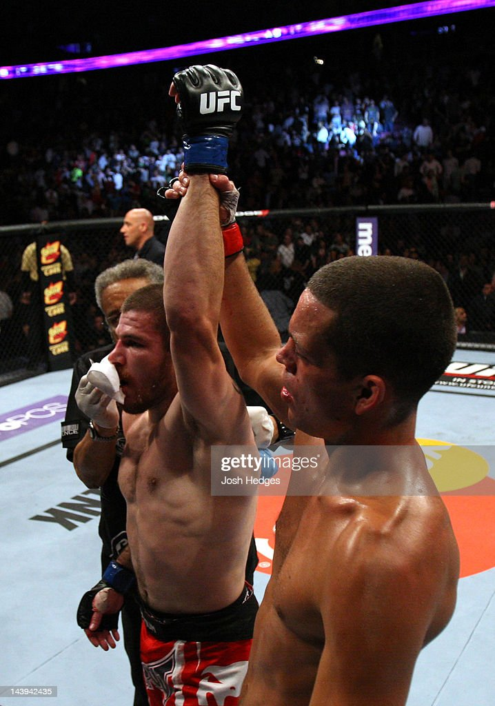 Nate Diaz (R) hold up Jim Miller (L) hand after defeating him in their Lightweight bout at Izod Center on May 5, 2012 in East Rutherford, New Jersey.
