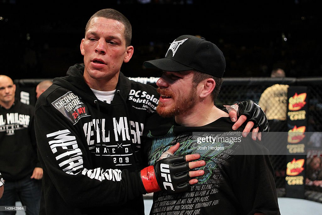 Nate Diaz (L) hugs Jim Miller (R) after defeating him in their Lightweight bout at Izod Center on May 5, 2012 in East Rutherford, New Jersey.