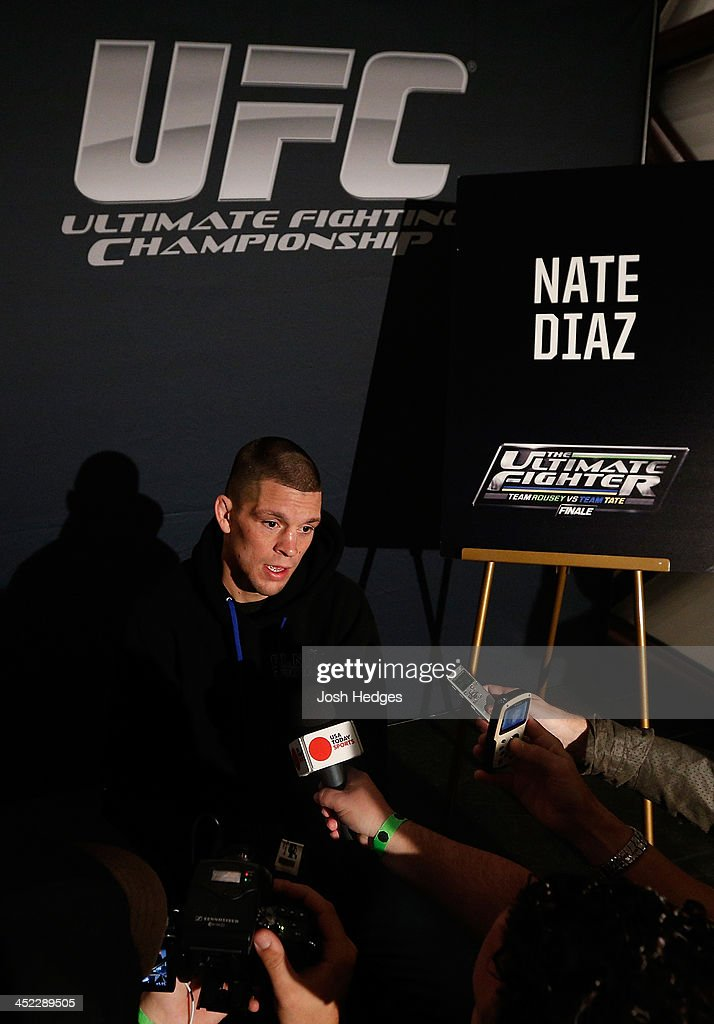<a gi-track='captionPersonalityLinkClicked' href=/galleries/search?phrase=Nate+Diaz&family=editorial&specificpeople=5532032 ng-click='$event.stopPropagation()'>Nate Diaz</a> interacts with media during media day ahead of The Ultimate Fighter season 18 live finale inside the Mandalay Bay Events Center on November 27, 2013 in Las Vegas, Nevada.