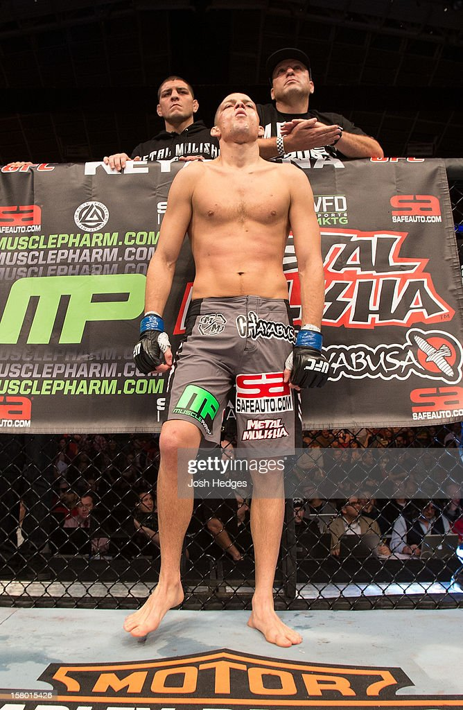 <a gi-track='captionPersonalityLinkClicked' href=/galleries/search?phrase=Nate+Diaz&family=editorial&specificpeople=5532032 ng-click='$event.stopPropagation()'>Nate Diaz</a> prepares to take on <a gi-track='captionPersonalityLinkClicked' href=/galleries/search?phrase=Benson+Henderson&family=editorial&specificpeople=8623964 ng-click='$event.stopPropagation()'>Benson Henderson</a> before their lightweight championship bout at the UFC on FOX event on December 8, 2012 at Key Arena in Seattle, Washington.