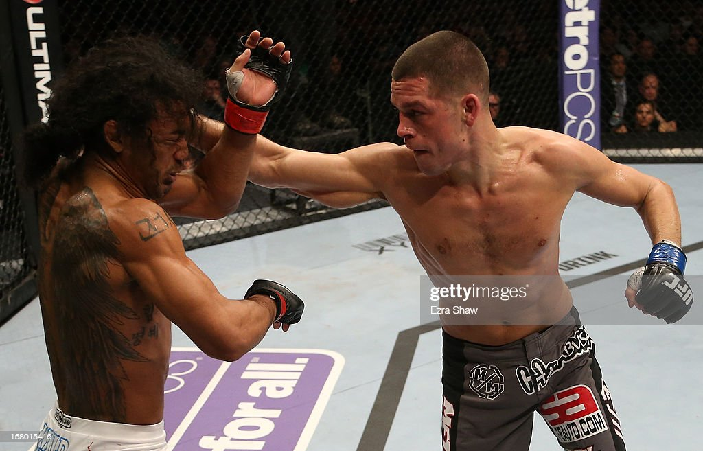 Nate Diaz punches Benson Henderson during their lightweight championship bout at the UFC on FOX event on December 8, 2012 at Key Arena in Seattle, Washington.