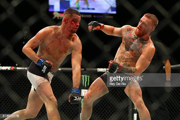 Nate Diaz punches Conor McGregor during UFC 196 at the MGM Grand Garden Arena on March 5 2016 in Las Vegas Nevada