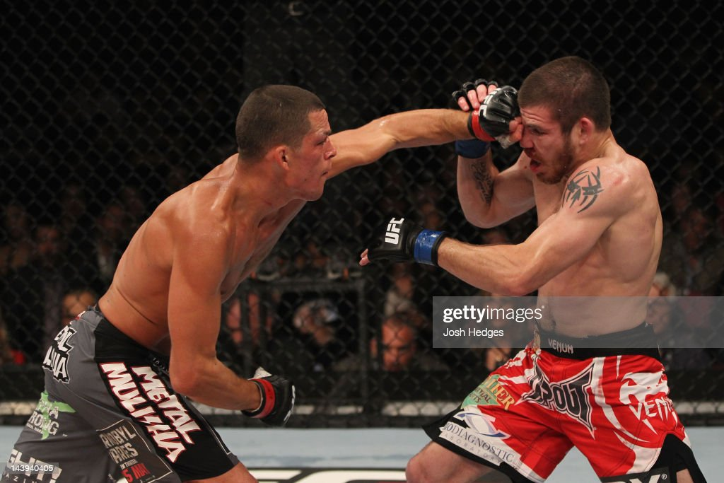 Nate Diaz (L) punches Jim Miller (R) during their Lightweight bout at Izod Center on May 5, 2012 in East Rutherford, New Jersey.