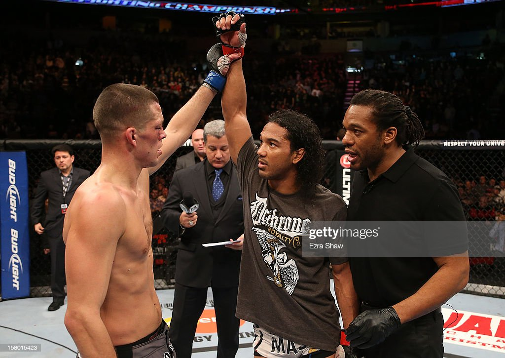 Nate Diaz (left) raises Benson Henderson's hand after their lightweight championship bout at the UFC on FOX event on December 8, 2012 at Key Arena in Seattle, Washington.