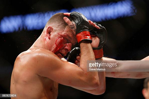 Nate Diaz takes a punch from Conor McGregor during their welterweight rematch at the UFC 202 event at TMobile Arena on August 20 2016 in Las Vegas...