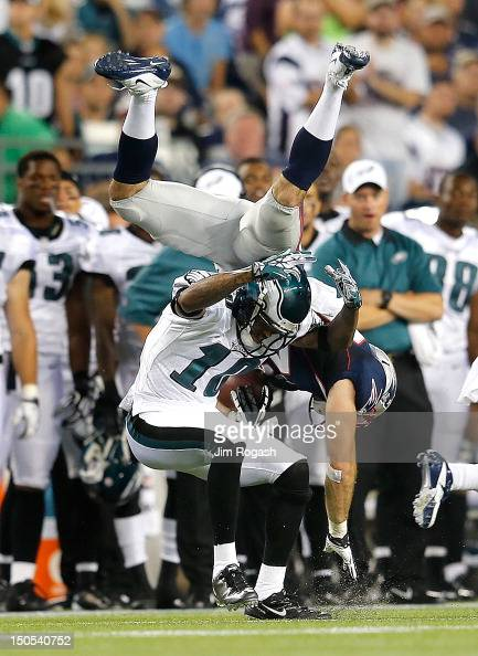 Nate Ebner of the New England Patriots tumbles over DeSean Jackson of the Philadelphia Eagles after Ebner intercepted a pass during a preseason game...