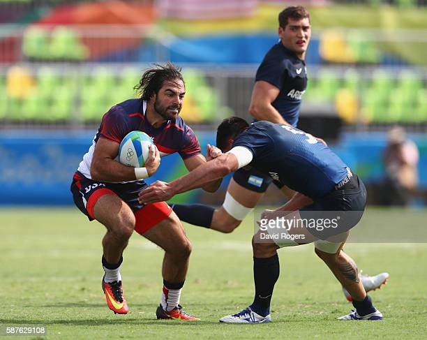 Nate Ebner of the United States is tackled by Axel Muller of Argentina during the Men's Rugby Sevens Pool A match between the United States and...