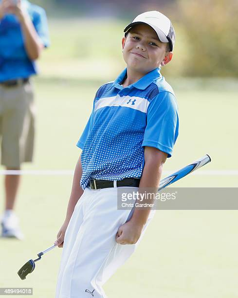 Nate Faulkner reacts as he watches one of his putts during the Drive Chip and Putt Tournament at the Congressional Country Club on September 20 2015...