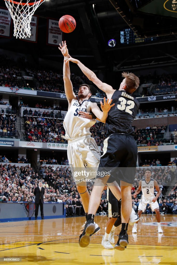 Nate Fowler #51 of the Butler Bulldogs shoots against Matt Haarms #32 of the Purdue Boilermakers in the second half of the Crossroads Classic at Bankers Life Fieldhouse on December 16, 2017 in Indianapolis, Indiana. Purdue won 82-67.