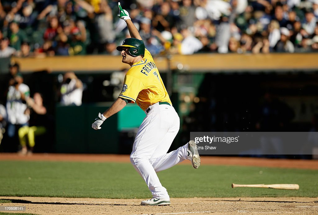 <a gi-track='captionPersonalityLinkClicked' href=/galleries/search?phrase=Nate+Freiman&family=editorial&specificpeople=9750566 ng-click='$event.stopPropagation()'>Nate Freiman</a> #7 of the Oakland Athletics celebrates as he runs up the first base line after he hit a single that scored <a gi-track='captionPersonalityLinkClicked' href=/galleries/search?phrase=John+Jaso&family=editorial&specificpeople=4951282 ng-click='$event.stopPropagation()'>John Jaso</a> #5 in the bottom of the 18th inning to beat the New York Yankees at O.co Coliseum on June 13, 2013 in Oakland, California.