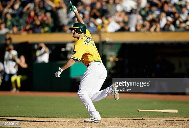 Nate Freiman of the Oakland Athletics celebrates as he runs up the first base line after he hit a single that scored John Jaso in the bottom of the...