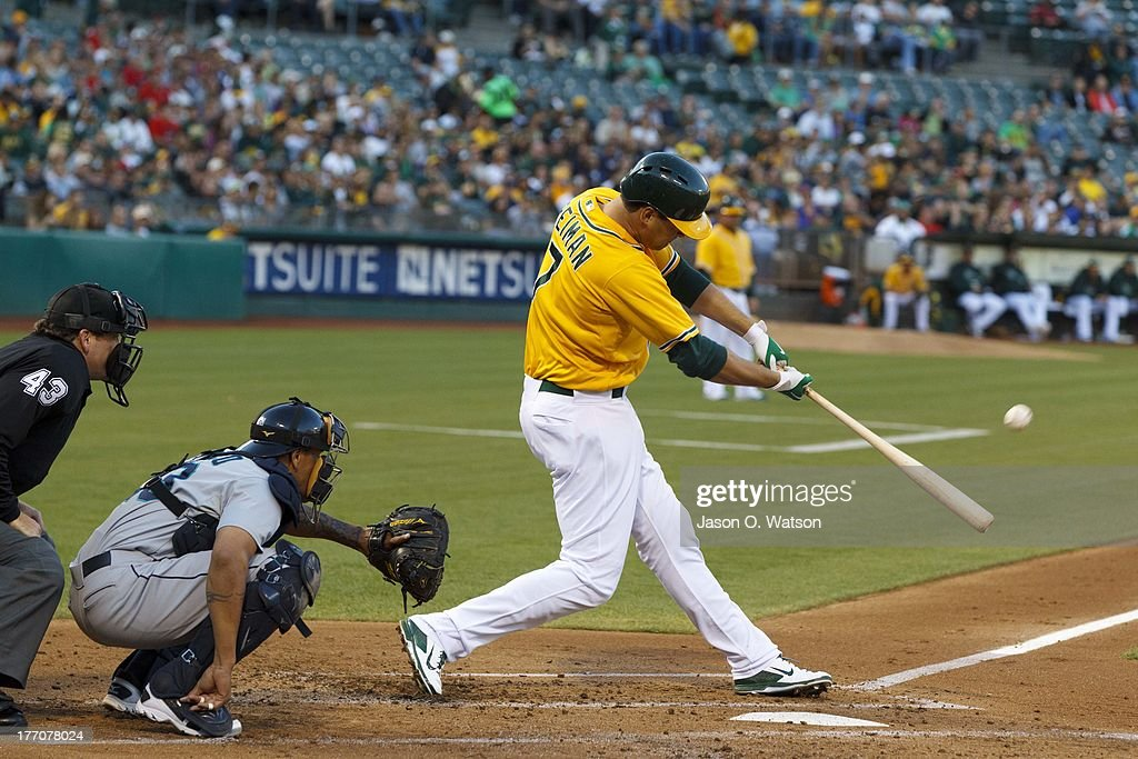<a gi-track='captionPersonalityLinkClicked' href=/galleries/search?phrase=Nate+Freiman&family=editorial&specificpeople=9750566 ng-click='$event.stopPropagation()'>Nate Freiman</a> #7 of the Oakland Athletics hits a home run against the Seattle Mariners during the first inning at O.co Coliseum on August 20, 2013 in Oakland, California.