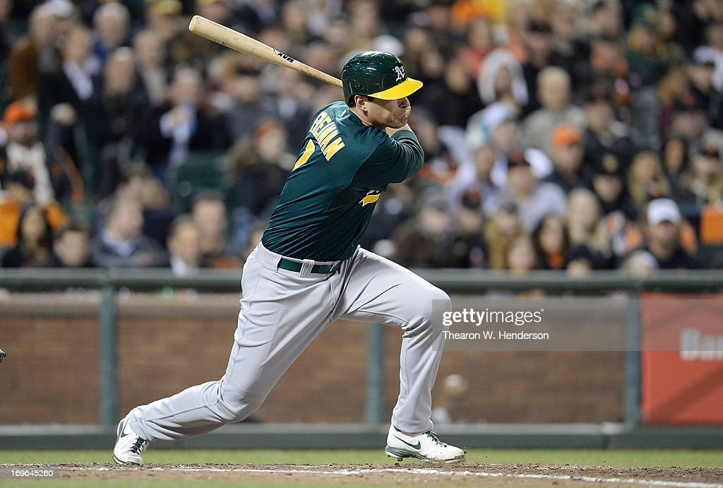 Nate Freiman #7 of the Oakland Athletics hits a two run single with the bases loaded, scoring Seth Smith #15 and Josh Donaldson #20 against the San Francisco Giants in the fifth inning at AT&T Park on May 29, 2013 in San Francisco, California.