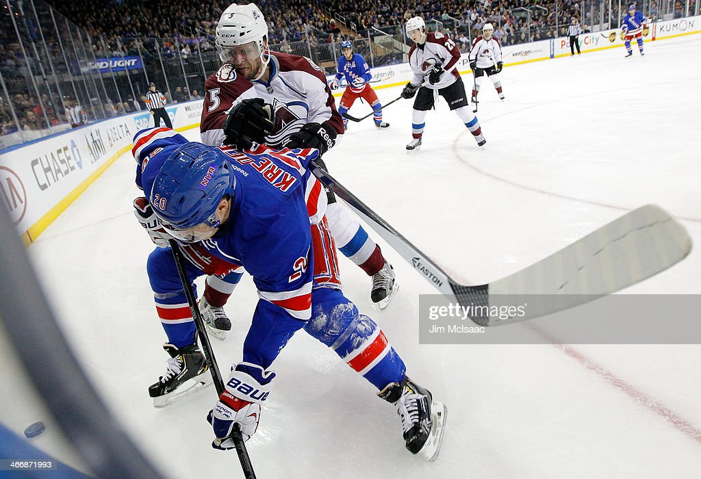 <a gi-track='captionPersonalityLinkClicked' href=/galleries/search?phrase=Nate+Guenin&family=editorial&specificpeople=3948510 ng-click='$event.stopPropagation()'>Nate Guenin</a> #5 of the Colorado Avalanche defends against <a gi-track='captionPersonalityLinkClicked' href=/galleries/search?phrase=Chris+Kreider&family=editorial&specificpeople=5894671 ng-click='$event.stopPropagation()'>Chris Kreider</a> #20 of the New York Rangers during their game at Madison Square Garden on February 4, 2014 in New York City.