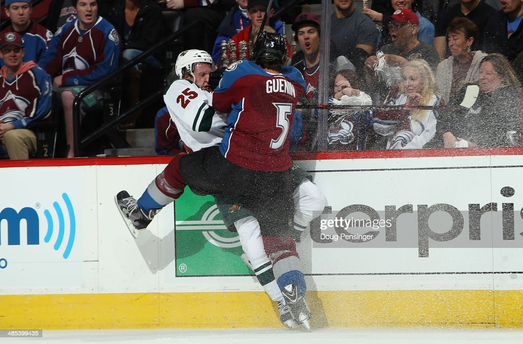 <a gi-track='captionPersonalityLinkClicked' href=/galleries/search?phrase=Nate+Guenin&family=editorial&specificpeople=3948510 ng-click='$event.stopPropagation()'>Nate Guenin</a> #5 of the Colorado Avalanche puts a hit on <a gi-track='captionPersonalityLinkClicked' href=/galleries/search?phrase=Jonas+Brodin&family=editorial&specificpeople=7832272 ng-click='$event.stopPropagation()'>Jonas Brodin</a> #25 of the Minnesota Wild in Game One of the First Round of the 2014 NHL Stanley Cup Playoffs at Pepsi Center on April 17, 2014 in Denver, Colorado.