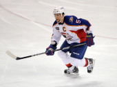Nate Guenin of the Norfolk Admirals skates during an American Hockey League game against the Bridgeport Sound Tigers on December 2 2012 at the...