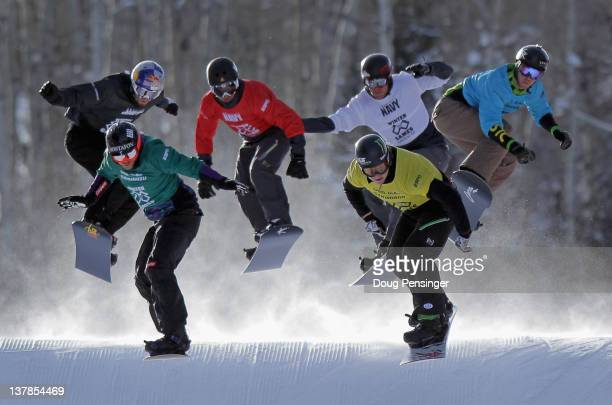 Nate Holland leads the field in his semifinal heat before advancing to the final and winning the gold medal in the men's snowboarder X during Winter...