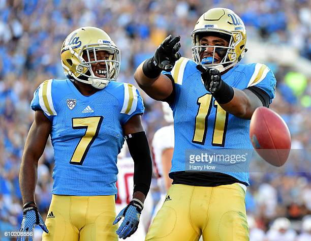 Nate Iese of the UCLA Bruins celebrates his touchdown with Darren Andrews to take a 73 lead over the Stanford Cardinal during the first quarter at...