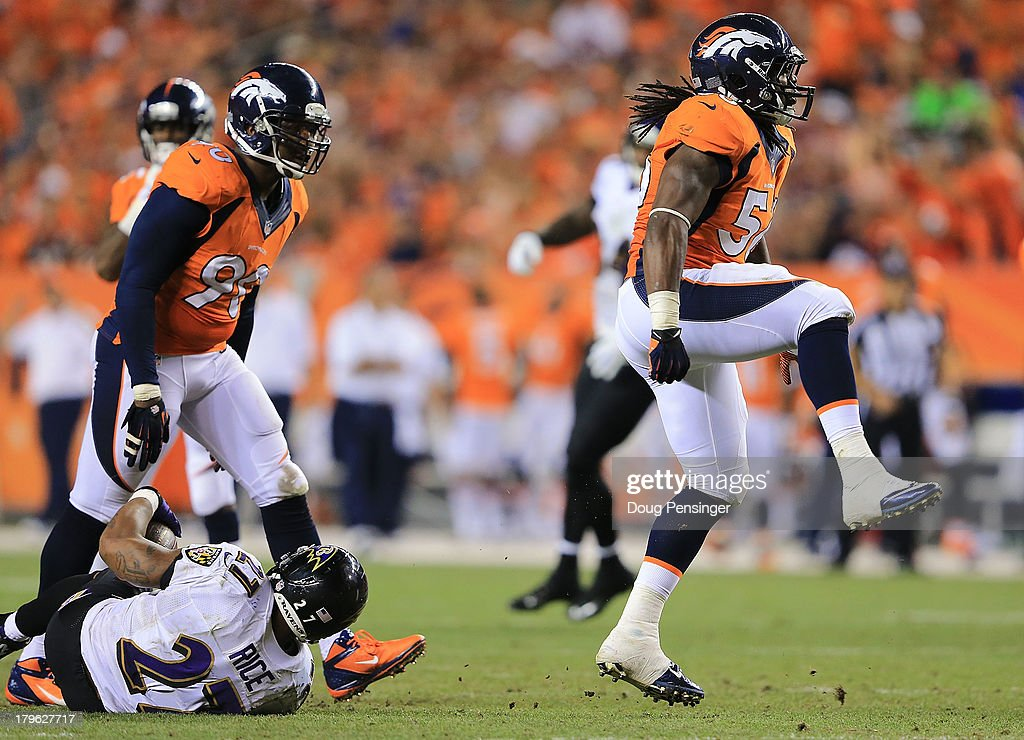 <a gi-track='captionPersonalityLinkClicked' href=/galleries/search?phrase=Nate+Irving&family=editorial&specificpeople=4753462 ng-click='$event.stopPropagation()'>Nate Irving</a> #56 of the Denver Broncos celebrates after tackling <a gi-track='captionPersonalityLinkClicked' href=/galleries/search?phrase=Ray+Rice&family=editorial&specificpeople=3980395 ng-click='$event.stopPropagation()'>Ray Rice</a> #27 of the Baltimore Ravens for a loss of 2 yards in the third quarter during the game at Sports Authority Field at Mile High on September 5, 2013 in Denver Colorado.