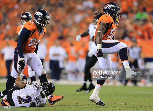 Nate Irving of the Denver Broncos celebrates after tackling Ray Rice of the Baltimore Ravens for a loss of 2 yards in the third quarter during the...