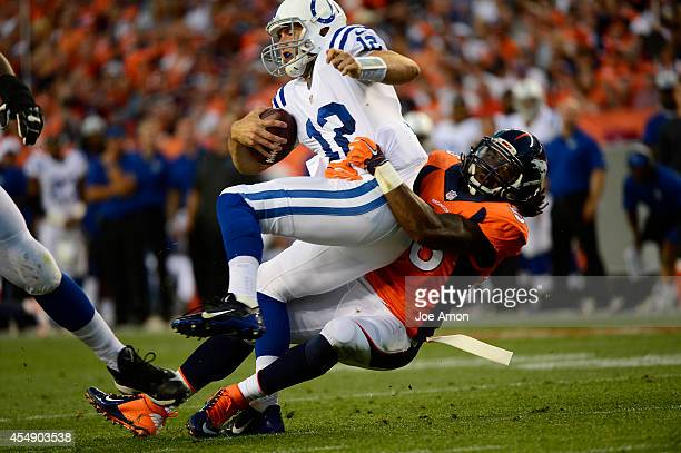Nate Irving of the Denver Broncos charges Andrew Luck of the Indianapolis Colts and sacks him in the second quarter The Denver Broncos played the...