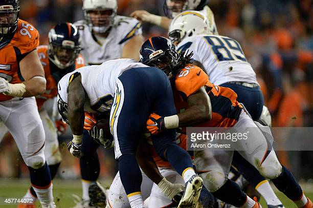 Nate Irving of the Denver Broncos stops Branden Oliver of the San Diego Chargers for no gain in the third quarter The Denver Broncos played the San...