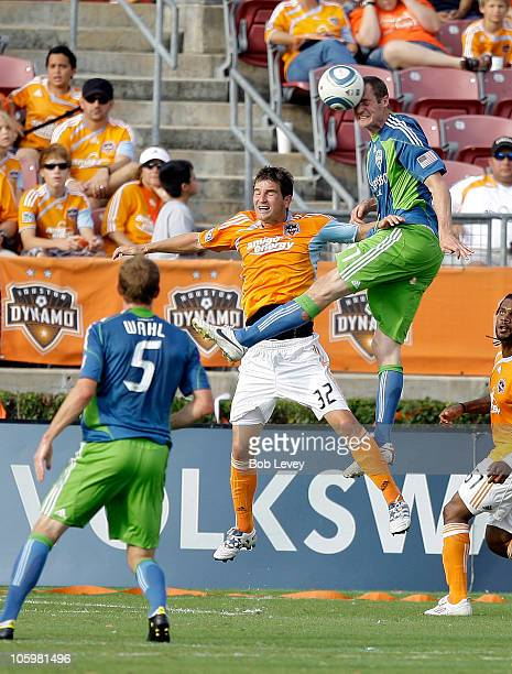 Nate Jaqua of the Seattle Sounders heads the ball away from Bobby Boswell of the Houston Dynamo in the second half at Robertson Stadium on October 23...