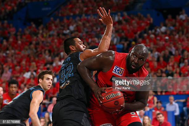 Nate Jawai of the Wildcats works to the basket against Tai Wesley of the Breakers during game one of the NBL Grand FInal series between the Perth...