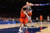 Nate Lubick of the Georgetown Hoyas has the ball knocked loses as he drove to the basket in the second half against Michael CarterWilliams of the...