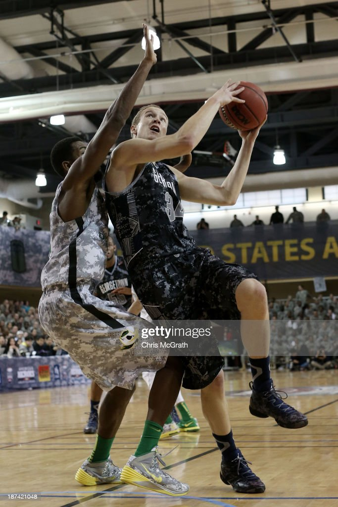 Nate Lubik #34 of the Georgetown Hoyas drives to the basket against the Oregon Ducks during the Armed Forces Classic at United States Army Garrison-Humphreys on November 9, 2013 in Pyeongtaek, South Korea.