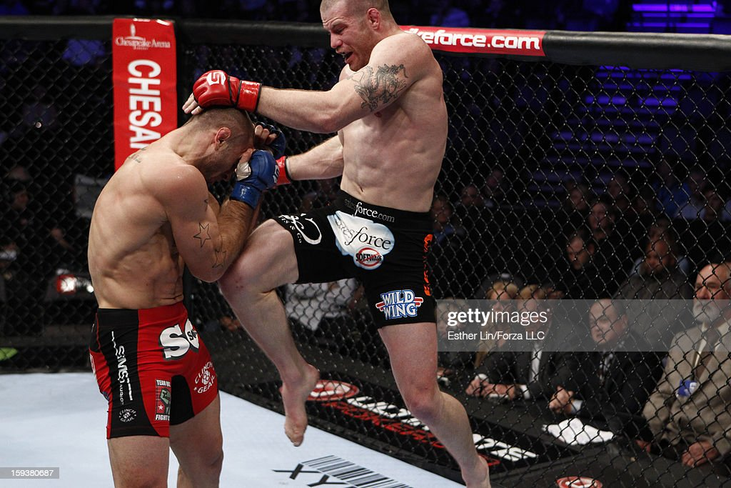 Nate Marquardt delivers a flying knee against Tarec Saffiedine in their welterweight championship bout during the Strikeforce event on January 12, 2013 at Chesapeake Energy Arena in Oklahoma City, Oklahoma.