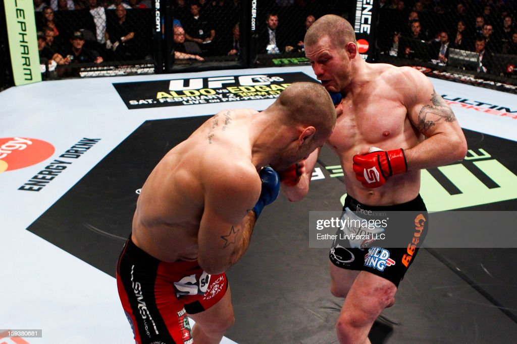Nate Marquardt punches Tarec Saffiedine in their welterweight championship bout during the Strikeforce event on January 12, 2013 at Chesapeake Energy Arena in Oklahoma City, Oklahoma.