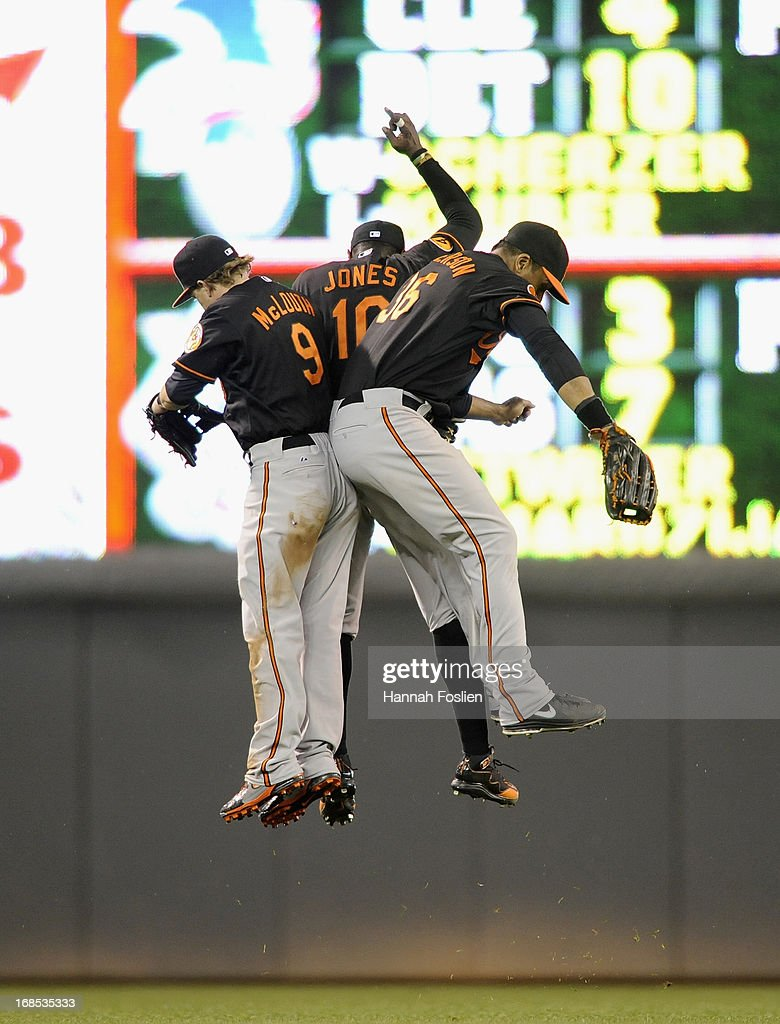 <a gi-track='captionPersonalityLinkClicked' href=/galleries/search?phrase=Nate+McLouth&family=editorial&specificpeople=536572 ng-click='$event.stopPropagation()'>Nate McLouth</a> #9, Adam Jones #10 and Chris Dickerson #36 of the Baltimore Orioles celebrate a win in ten innings against the Minnesota Twins on May 10, 2013 at Target Field in Minneapolis, Minnesota. The Orioles defeated the Twins 9-6.