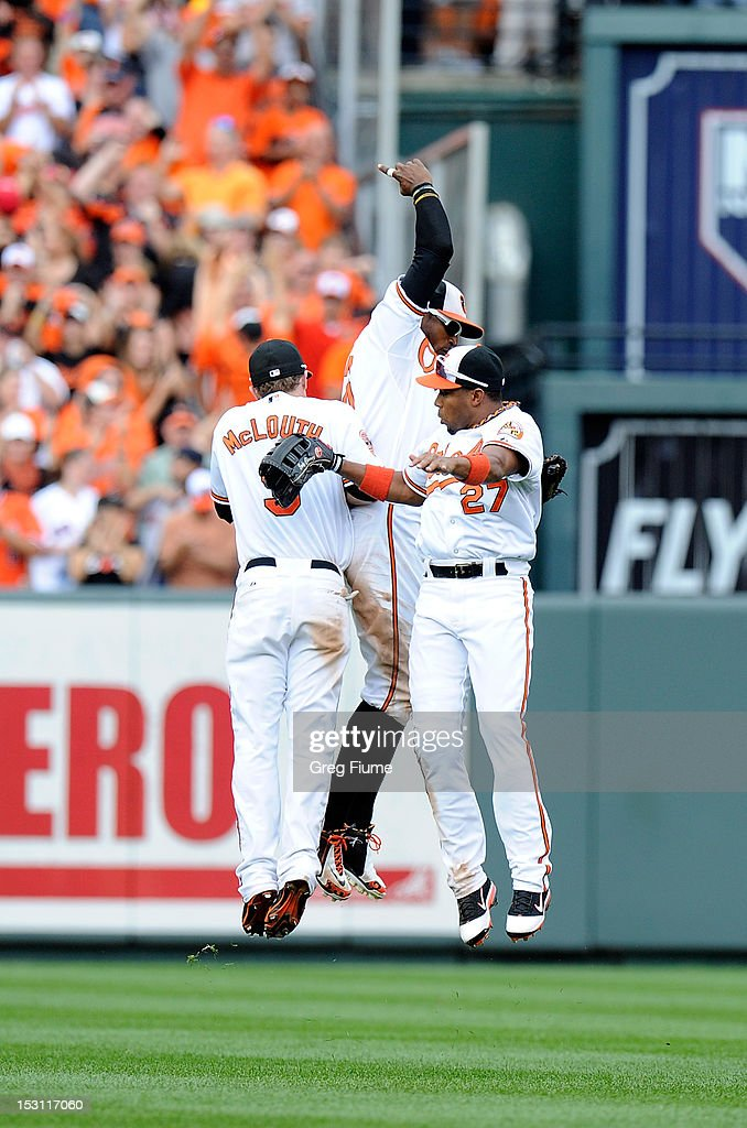 <a gi-track='captionPersonalityLinkClicked' href=/galleries/search?phrase=Nate+McLouth&family=editorial&specificpeople=536572 ng-click='$event.stopPropagation()'>Nate McLouth</a> #9, Adam Jones #10 and <a gi-track='captionPersonalityLinkClicked' href=/galleries/search?phrase=Endy+Chavez&family=editorial&specificpeople=216624 ng-click='$event.stopPropagation()'>Endy Chavez</a> #27 of the Baltimore Orioles celebrate after a 6-3 victory against the Boston Red Sox at Oriole Park at Camden Yards on September 30, 2012 in Baltimore, Maryland.