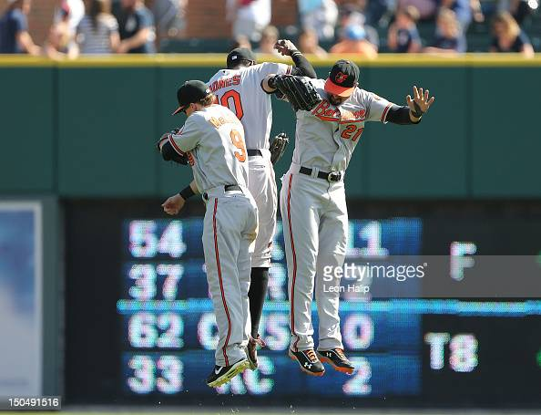 Nate McLouth Adam Jones and Nick Markakis of the Baltimore Orioles celebrate a win over the Detroit Tigers at Comerica Park on August 19 2012 in...