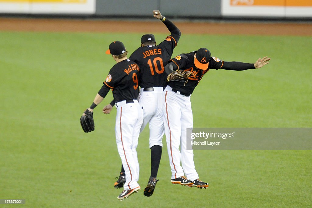 <a gi-track='captionPersonalityLinkClicked' href=/galleries/search?phrase=Nate+McLouth&family=editorial&specificpeople=536572 ng-click='$event.stopPropagation()'>Nate McLouth</a> #9, Adam Jones #10 and <a gi-track='captionPersonalityLinkClicked' href=/galleries/search?phrase=Nick+Markakis&family=editorial&specificpeople=614708 ng-click='$event.stopPropagation()'>Nick Markakis</a> #21 of the Baltimore Orioles celebrate a win after a baseball game against the Toronto Blue Jays on July 12, 2013 at Oriole Park at Camden Yards in Baltimore, Maryland. The Orioles won 8-5.