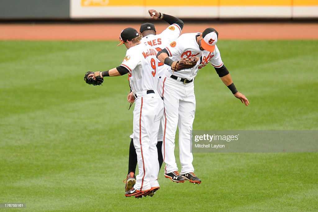 <a gi-track='captionPersonalityLinkClicked' href=/galleries/search?phrase=Nate+McLouth&family=editorial&specificpeople=536572 ng-click='$event.stopPropagation()'>Nate McLouth</a> #9, Adam Jones #10, and <a gi-track='captionPersonalityLinkClicked' href=/galleries/search?phrase=Nick+Markakis&family=editorial&specificpeople=614708 ng-click='$event.stopPropagation()'>Nick Markakis</a> #21 of the Baltimore Orioles celebrate a win after a baseball game against the Colorado Rockies on August 18, 2013 at Oriole Park at Camden Yards in Baltimore, Maryland. The Orioles won 7-2.