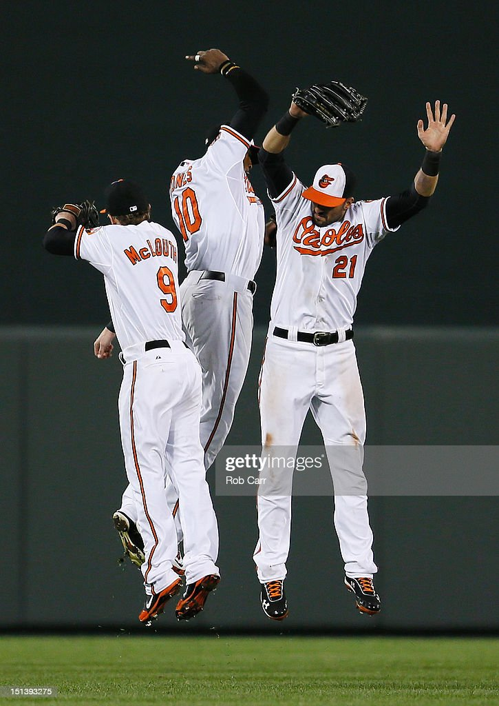 <a gi-track='captionPersonalityLinkClicked' href=/galleries/search?phrase=Nate+McLouth&family=editorial&specificpeople=536572 ng-click='$event.stopPropagation()'>Nate McLouth</a> #9, Adam Jones #10, and <a gi-track='captionPersonalityLinkClicked' href=/galleries/search?phrase=Nick+Markakis&family=editorial&specificpeople=614708 ng-click='$event.stopPropagation()'>Nick Markakis</a> #21 of the Baltimore Orioles celebrate after the Orioles defeated the New York Yankees 10-6 at Oriole Park at Camden Yards on September 6, 2012 in Baltimore, Maryland.