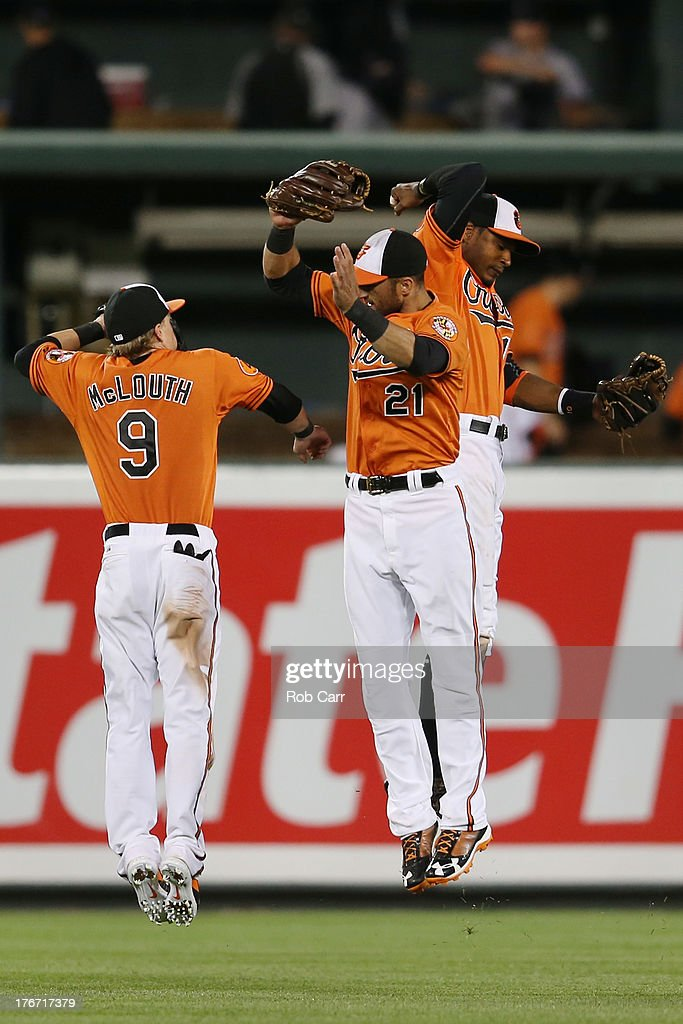 <a gi-track='captionPersonalityLinkClicked' href=/galleries/search?phrase=Nate+McLouth&family=editorial&specificpeople=536572 ng-click='$event.stopPropagation()'>Nate McLouth</a> #9, Adam Jones #10, and <a gi-track='captionPersonalityLinkClicked' href=/galleries/search?phrase=Nick+Markakis&family=editorial&specificpeople=614708 ng-click='$event.stopPropagation()'>Nick Markakis</a> #21 of the Baltimore Orioles celebrate following the Orioles 8-4 win over the Colorado Rockies at Oriole Park at Camden Yards on August 17, 2013 in Baltimore, Maryland.