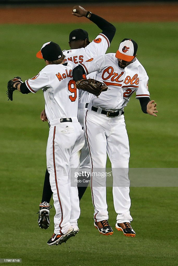 <a gi-track='captionPersonalityLinkClicked' href=/galleries/search?phrase=Nate+McLouth&family=editorial&specificpeople=536572 ng-click='$event.stopPropagation()'>Nate McLouth</a> #9, Adam Jones #10, and <a gi-track='captionPersonalityLinkClicked' href=/galleries/search?phrase=Nick+Markakis&family=editorial&specificpeople=614708 ng-click='$event.stopPropagation()'>Nick Markakis</a> #21 of the Baltimore Orioles celebrate after the Orioles defeated the Chicago White Sox 3 -1 at Oriole Park at Camden Yards on September 5, 2013 in Baltimore, Maryland.