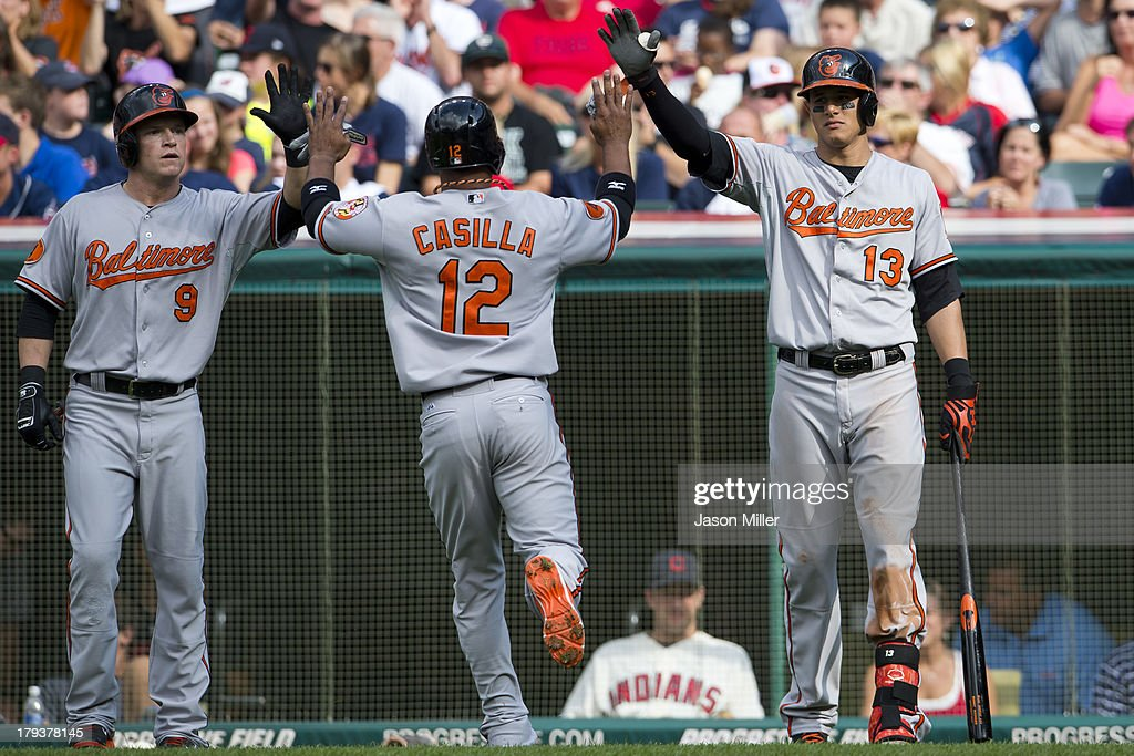 <a gi-track='captionPersonalityLinkClicked' href=/galleries/search?phrase=Nate+McLouth&family=editorial&specificpeople=536572 ng-click='$event.stopPropagation()'>Nate McLouth</a> #9 <a gi-track='captionPersonalityLinkClicked' href=/galleries/search?phrase=Alexi+Casilla&family=editorial&specificpeople=4180372 ng-click='$event.stopPropagation()'>Alexi Casilla</a> #12 and <a gi-track='captionPersonalityLinkClicked' href=/galleries/search?phrase=Manny+Machado&family=editorial&specificpeople=5591039 ng-click='$event.stopPropagation()'>Manny Machado</a> #13 of the Baltimore Orioles celebrate after Casilla scored during the second inning and at Progressive Field on September 2, 2013 in Cleveland, Ohio.