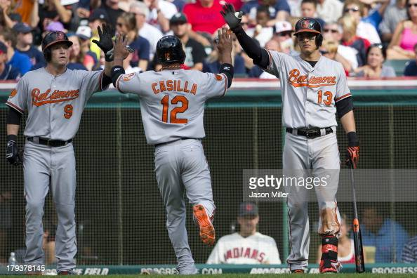 Nate McLouth Alexi Casilla and Manny Machado of the Baltimore Orioles celebrate after Casilla scored during the second inning and at Progressive...