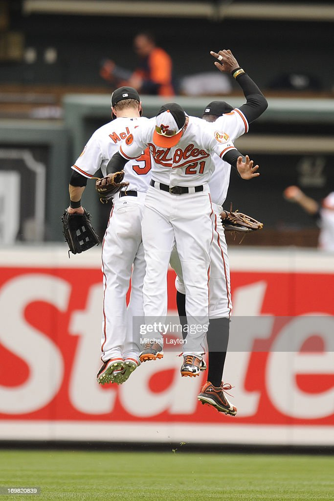 Nate McLouth Nick Markais and Adam Jones of the Baltimore Orioles celebrate a win after a baseball game against the Detroit Tigers on June 2 2013 at...