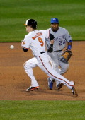 Nate McLouth of the Baltimore Orioles advances to third base on a hit as Miguel Tejada of the Kansas City Royals waits to field the ball during the...