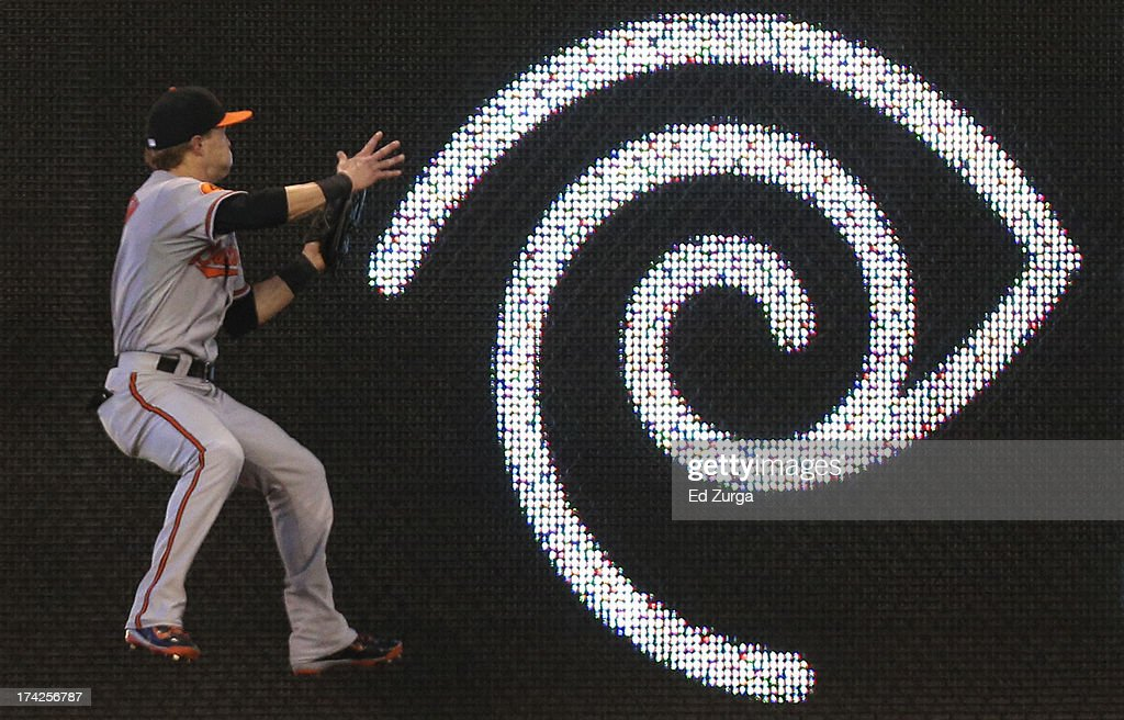 <a gi-track='captionPersonalityLinkClicked' href=/galleries/search?phrase=Nate+McLouth&family=editorial&specificpeople=536572 ng-click='$event.stopPropagation()'>Nate McLouth</a> #9 of the Baltimore Orioles collides with the wall as he catches a ball hit by Lorenzo Cain of the Kansas City Royals in the fourth inning at Kauffman Stadium on July 22, 2013 in Kansas City, Missouri.