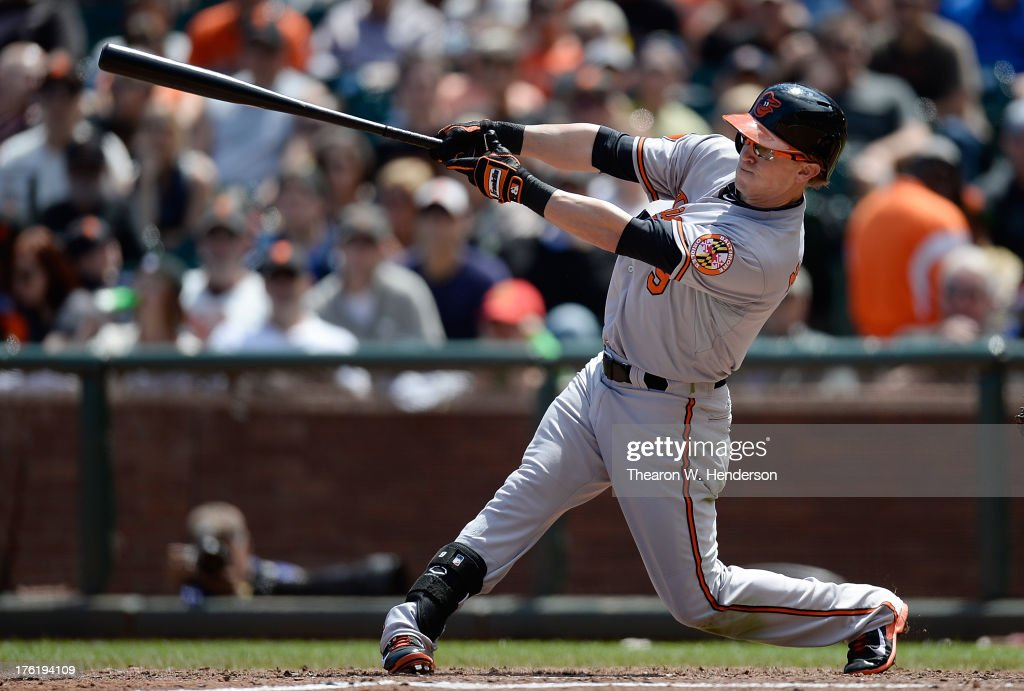 <a gi-track='captionPersonalityLinkClicked' href=/galleries/search?phrase=Nate+McLouth&family=editorial&specificpeople=536572 ng-click='$event.stopPropagation()'>Nate McLouth</a> #9 of the Baltimore Orioles hits an RBI single scoring Brian Roberts #1 in the sixth inning against the San Francisco Giants at AT&T Park on August 11, 2013 in San Francisco, California.